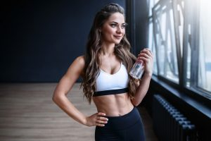 Fit Woman Holding Water Bottle